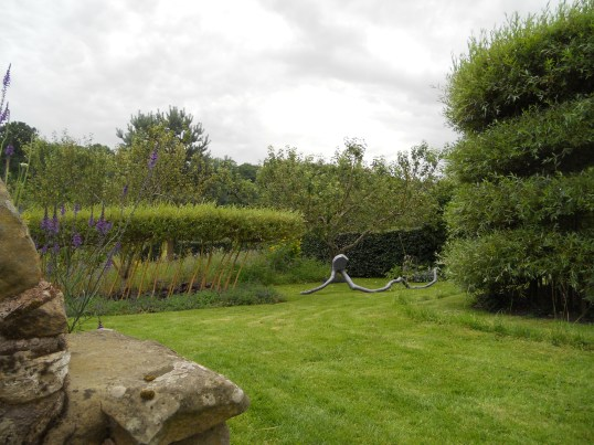 The garden featuring some of Charlie's living sculptures and a Nigel Ross sculpture in wood.
