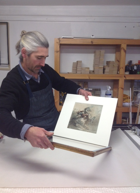 Vincent Lomenech in his Belford Studio reframing the prized Gericault