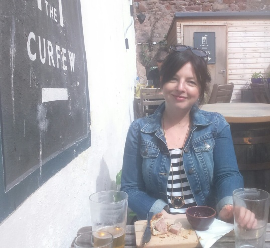 It's all about the books (nearly). Dawn enjoys a lunchtime pie and pint at Berwick's Curfew Micropub.